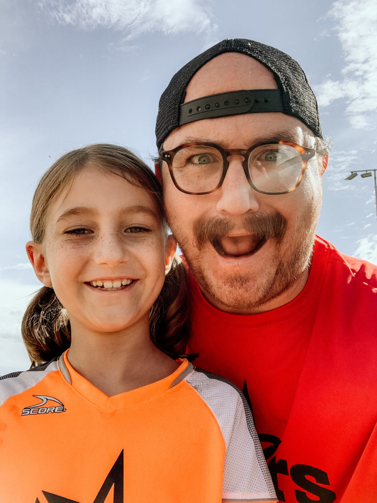 Me and my daughter at a soccer game to illustrate the mistakes freelancers make on Upwork