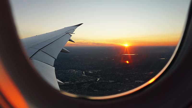 A plane window view to symbolize how to become a digital nomad